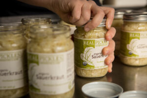 Packing Real Pickles Organic Sauerkraut